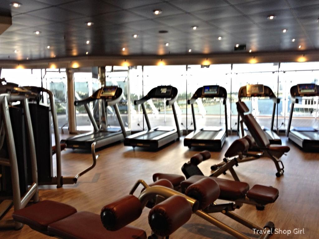 Treadmills and strength training equipment inside the fitness center