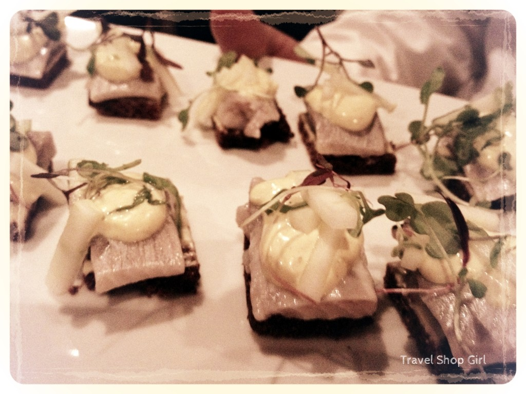 Pickled herring with curry dressing, green apples and spring onions on sweet rye bread