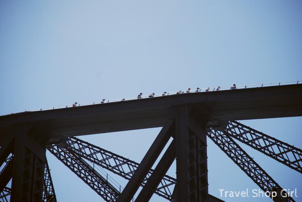 BridgeClimb climbers trekking across the bridge