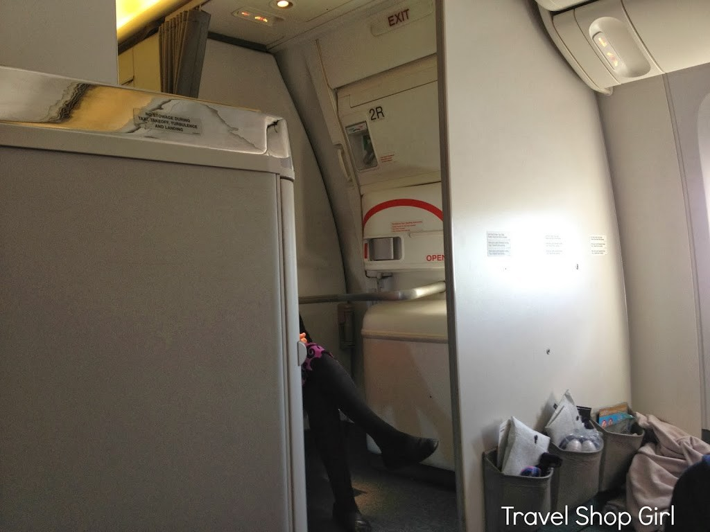 Our seat in row 23 gave us a view of the bulkhead and the seated flight attendant